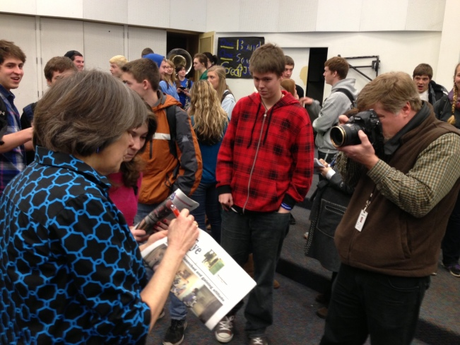 May Beth Tinker autographing copies of the Ferndale High School student newspaper, The Eagle Eye, for its student editors.