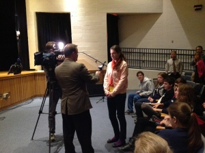 Reporter Tom Lewis from the local ABC news station interviews students before the Tinker Tour speech.