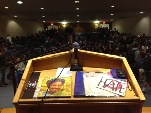 Students at South Hadley High School file into the school's auditorium to hear a presentation by Mary Beth Tinker Sept. 24. The podium includes some of the artifacts from her case that she often shares with students, including some of the actual hate mail received by her family.