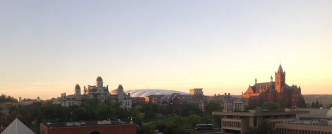 Syracuse University. The sunrise brings a glow to the Carrier Dome is in the background.