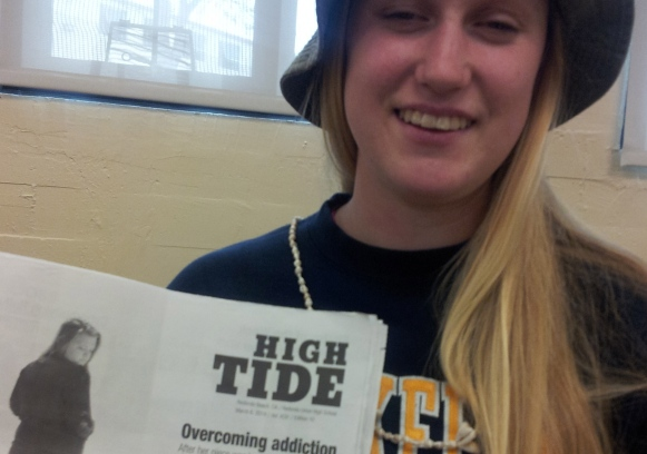 Nina Gomez, staff writer, with her article about a student who overcame addiction