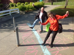 "Mary Beth Tinker and Mike Hiestand cross the ""official"" Tinker Tour finish line at Mountlake Terrace High School May 1"